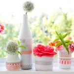 Latas já decoradas artesanalmente para enfeites de mesa.